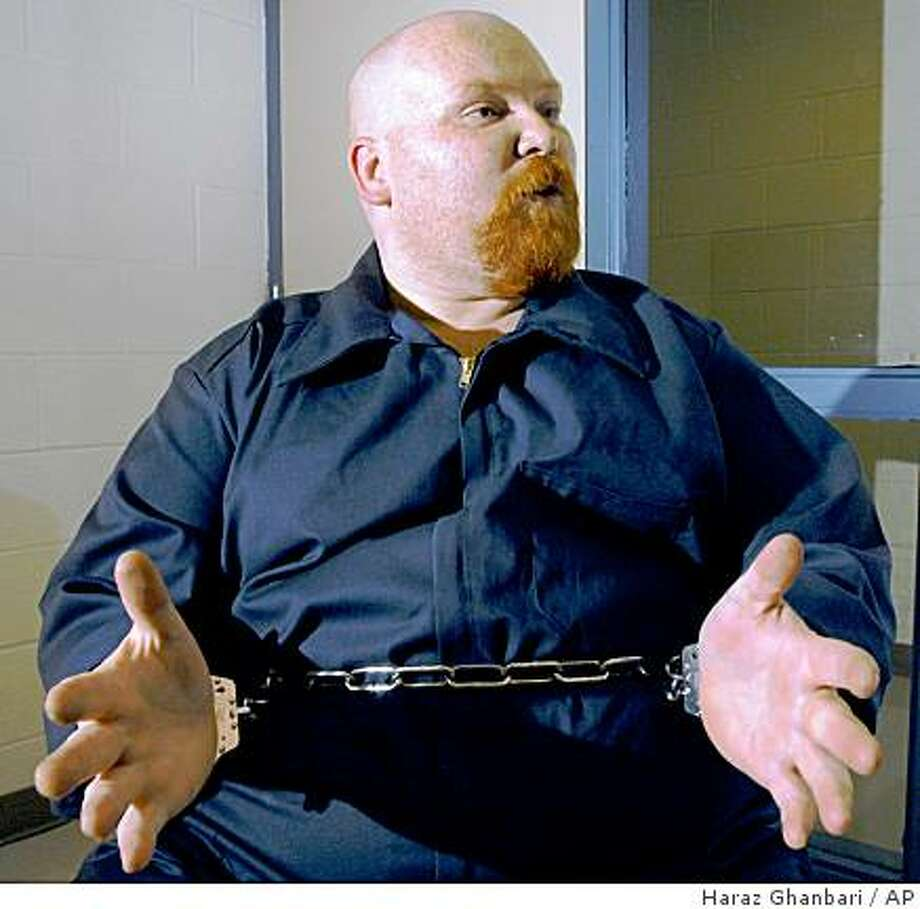** FILE **  In a July 14, 2003 file photo Richard Cooey gestures during an interview  at the Mansfield Correctional Institution in Mansfield, Ohio. Cooey, the first inmate to die by lethal injection in Ohio in more than a year argued to the end that his obesity would make it difficult for prison staff to find suitable veins in his arms to deliver the deadly chemicals. (AP Photo/The Columbus Dispatch, Haraz Ghanbari, File) Photo: Haraz Ghanbari, AP