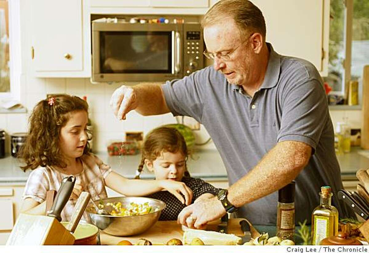 Chris Shepherd, chef of Bellanico, at home, with his two daughters, Gabriella (left), 6, and Nicoletta (middle), 4, making corn and heirloom tomato salad, in Oakland, Calif., on October, 3, 2008.