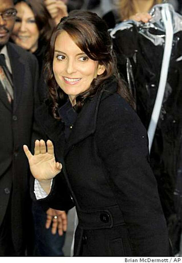 "** FILE ** In this Oct. 13, 2008 file photo, actress Tina Fey arrives for a taping of the ""Late Show With David Letterman""  in New York.  (AP Photo/Brian McDermott, file) Photo: Brian McDermott, AP"