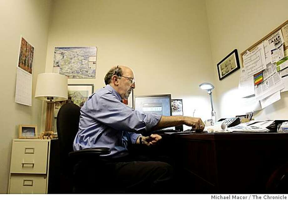 "Ken Greenberg, is the owner of ""Express Employment Professionals of Pleasanton"". Greenberg phones clients from his Pleasanton, Calif. offices on Wednesday Oct. 15, 2008. Greenberg himself spent two years unemployed, before deciding it was time to reinvent himself. He now says he's on the front lines of the employment crisis in California. Photo: Michael Macor, The Chronicle"