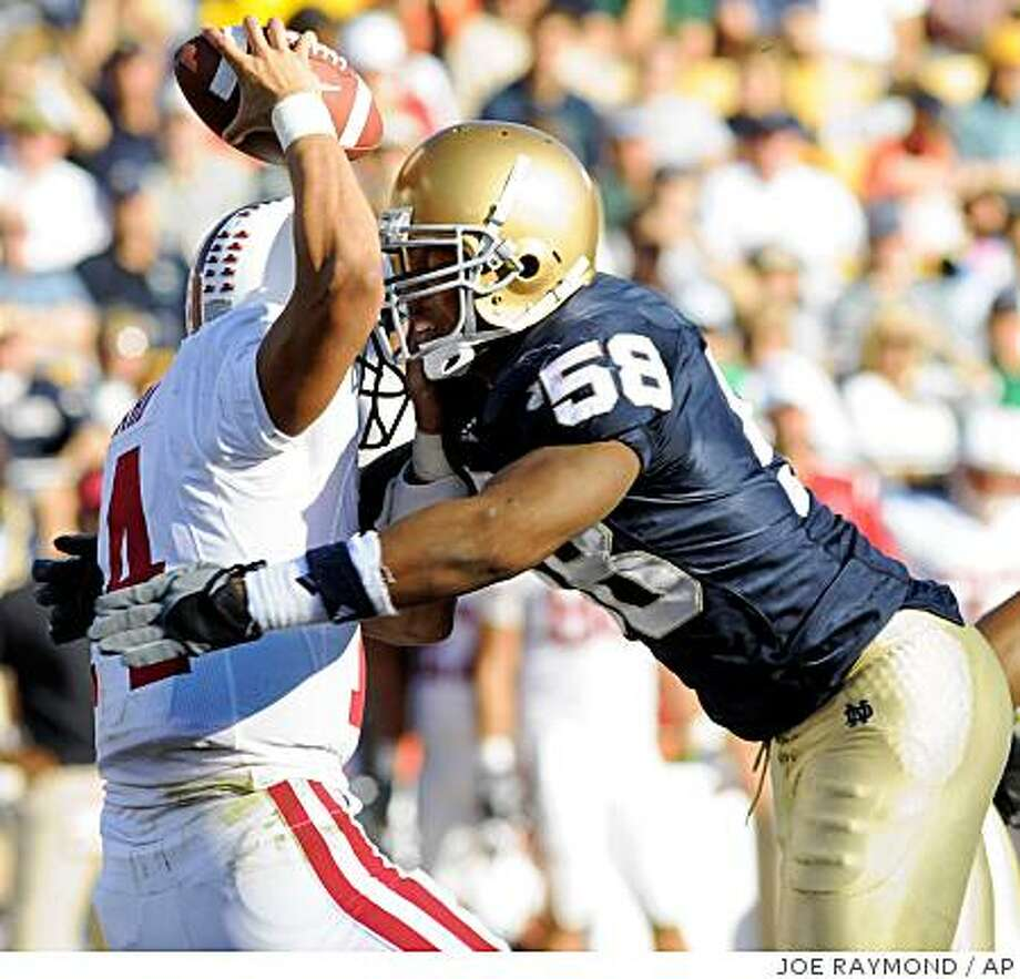 Stanford quarterback Tavita Pritchard, left, is sacked by Notre Dame linebacker Brian Smith during third-quarter action in an NCAA college football game Saturday, Oct. 4, 2008, in South Bend, Ind. Notre Dame won 28-21. (AP Photo/Joe Raymond) Photo: JOE RAYMOND, AP