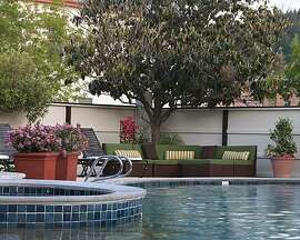 The outdoor pool with sofa at Roman Spa Resort and Baths.