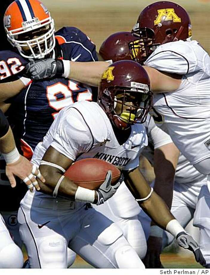 Minnesota's DeLeon Eskridge, center, breaks free of Illinois' Josh Brent (92) during the first half of the NCAA college football game at the University of Illinois in Champaign, Ill., Saturday, Oct. 11, 2008. (AP Photo/Seth Perlman) Photo: Seth Perlman, AP