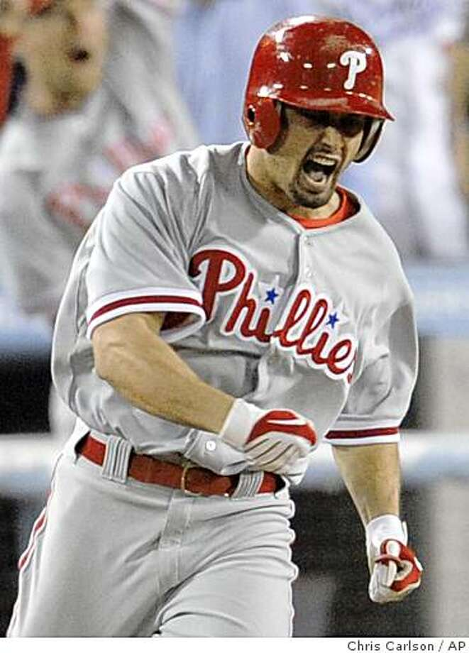 Philadelphia Phillies' Shane Victorino celebrates his two-run home run to tie the game against Los Angeles Dodgers during the 8th inning in Game 4 of the National League baseball championship series Monday, Oct. 13, 2008, in Los Angeles. (AP Photo/Chris Carlson) Photo: Chris Carlson, AP