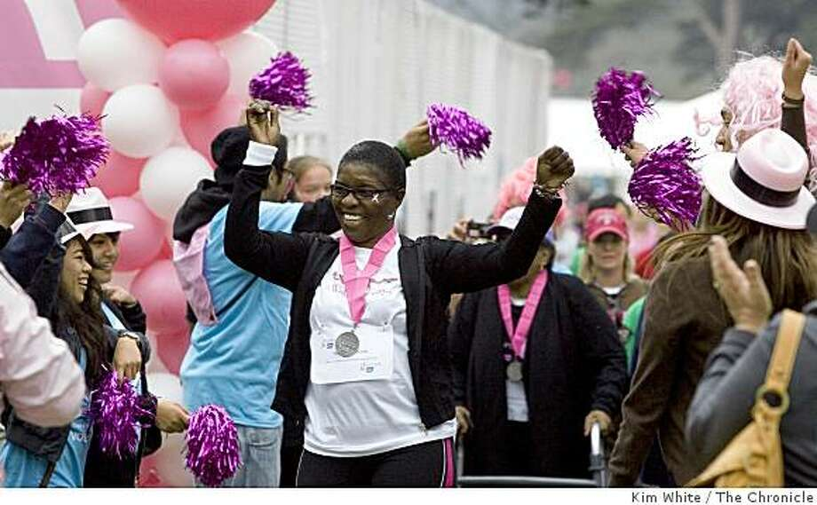 "Participants in the American Cancer Society ""Making Strides Against Breast Cancer Walk"" are cheered on as they begin the walk in Golden Gate Park in San Francisco , Calif., on Saturday, October 18, 2008. Photo: Kim White, The Chronicle"