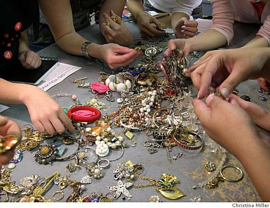 Volunteers sort jewelry donations at Academy of Art University. Photo: Christina Miller