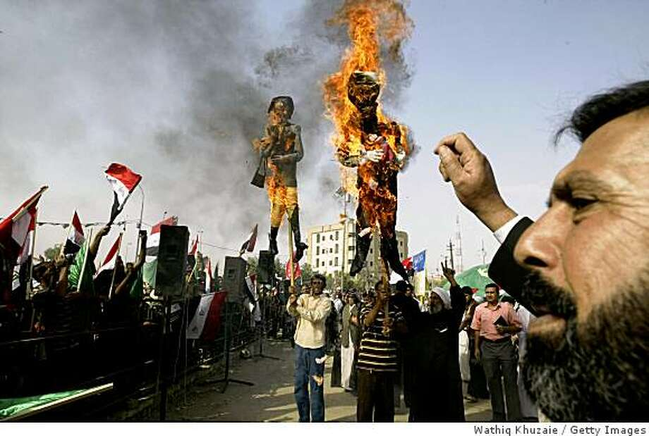BAGHDAD, IRAQ - OCTOBER 18:  Iraqi Shiite demonstrators burn effigies of U.S. President George W. Bush and U.S. Secretary of State Condoleezza Rice during a protest against a proposed U.S.-Iraqi security pact October 18, 2008 in Baghdad, Iraq. Supporters of radical Shiite cleric Moqtada al-Sadr protested against the agreement which would replace the existing U.N. mandate authorizing the U.S.-led forces in Iraq. The new agreement would require American forces to leave by December 31, 2011 unless the Iraqi government asked them to stay.  (Photo by Wathiq Khuzaie/Getty Images) Photo: Wathiq Khuzaie, Getty Images