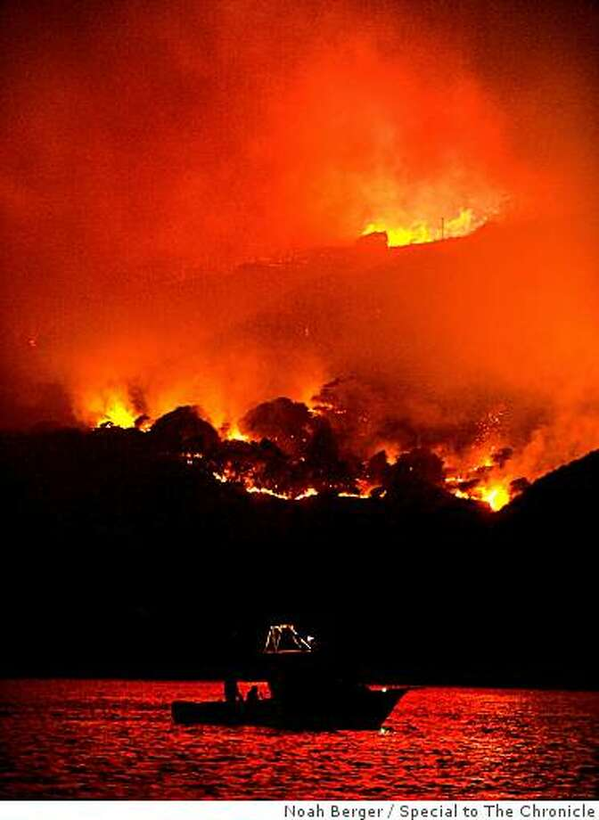 A wildfire spread across Angel Island on Sunday night. Photo: Noah Berger, Special To The Chronicle