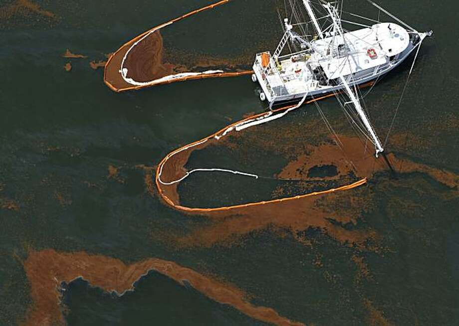 A shrimp boat is used to collect oil with booms in the waters of Chandeleur Sound, La., Wednesday, May 5, 2010. Photo: Eric Gay, AP