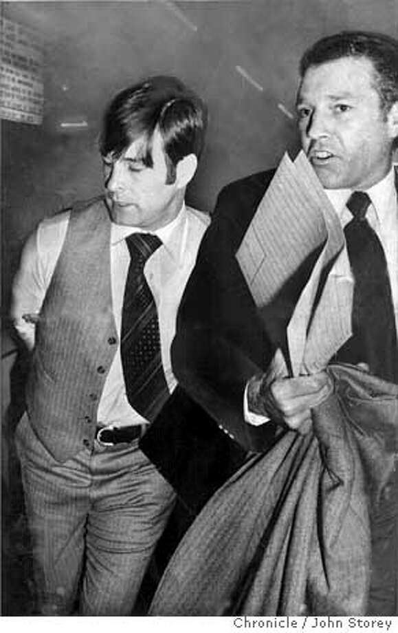 Supervisor Dan White, taken into custody by Inspector Howard Bailey, SFPD, in the basement of the Hall of Justice. White was charged with the murder of Mayor George Moscone and Supervisor Harvey Milk. Photo by John Storey Photo: JOHN STOREY