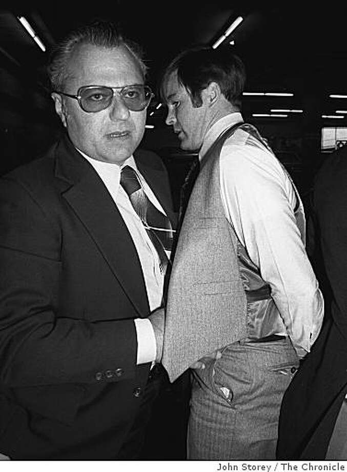 Supervisor Dan White under arrest at the Hall of Justice. Inspector Howard Bailey, takes White through the basement of the Hall of Justice for the murders of Mayor George Moscone and Supervisor Harvey Milk.  November 27, 1978. Photo: John Storey, The Chronicle
