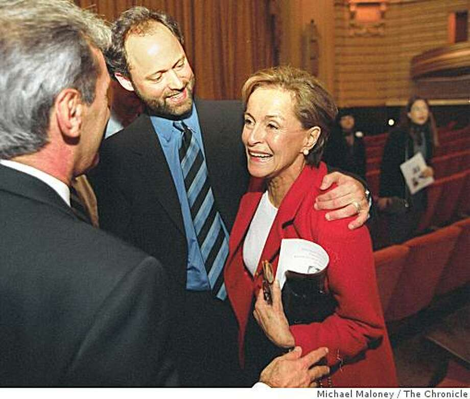 Gina Moscone and her son, Jonathan Moscone (center), talk to a well-wisher after a 20 year commemoration of the death of George Moscone and Harvey Milk at the War Memorial Opera House in San Francisco, Calif., November 24, 1998. Photo: Michael Maloney, The Chronicle