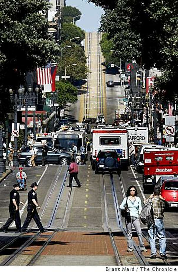 Tourists used the tracks to take pictures and Muni provided a bus line on Powell Street. The cable car lines serving Powell and Mason Streets were not running Thursday October 16, 2008 as a frayed cable was repaired. Photo: Brant Ward, The Chronicle