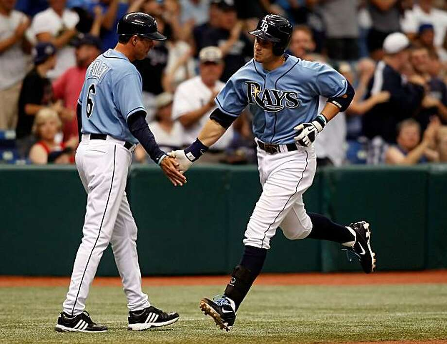 ST PETERSBURG, FL - MAY 02:  Infielder Evan Longoria #3 of the Tampa Bay Rays is congratulated by third base coach Tom Foley #6 as he rounds the bases after his fourth inning home run against the Kansas City Royals during the game at Tropicana Field on May 2, 2010 in St. Petersburg, Florida. Photo: J. Meric, Getty Images