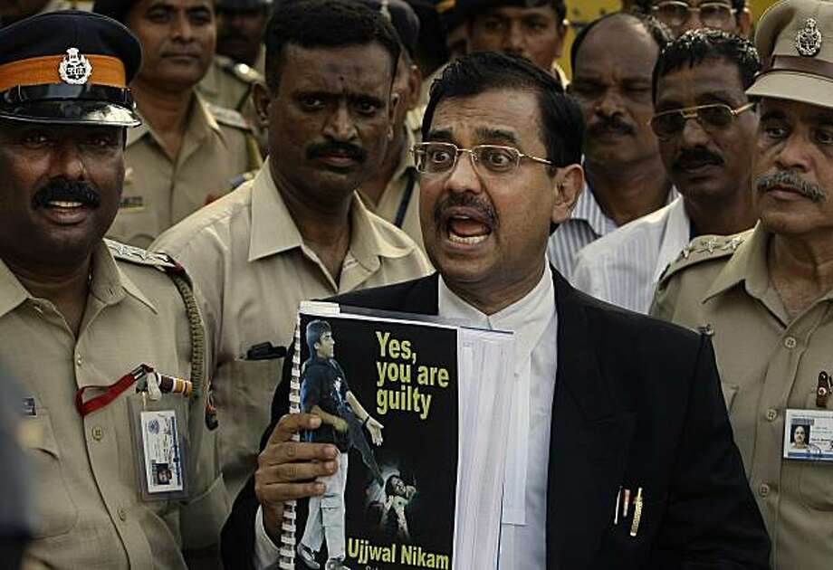 India's Special Public prosecutor Ujjwal Nikam, center, speaks to reporters as he holds a report following the verdict outside the special court set up for the trial of Pakistani Mohammed Ajmal Kasab, accused of being the sole surviving gunman in the 2008terror attacks in Mumbai, India, Monday, May 3, 2010. The Indian court on Monday convicted the Pakistani man of murder and waging war for his role in the 2008 Mumbai terror attacks that left 166 people dead in the heart of India's financial capital. Photo: Rajanish Kakade, AP