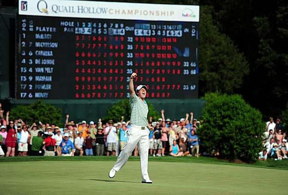 Rory McIlroy celebrates his birdie, and championship, on the 18th green in the final round of the 2010 Quail Hollow Championship at Quail Hollow Club in Charlotte, North Carolina, Sunday, May 2, 2010. (Jeff Siner/Charlotte Observer/MCT) Photo: Jeff Siner, MCT