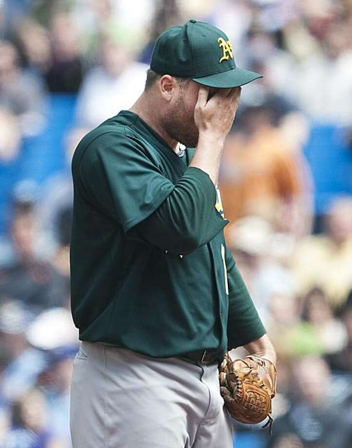 Oakland Athletics starting pitcher Ben Sheets wipes his face while playing against the Toronto Blue Jays during second inning AL action in Toronto on Sunday, May 2, 2010. Photo: Nathan Denette, AP