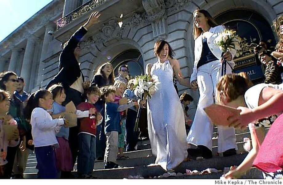 Erin Carder's 1st grade class from Creative Arts Charter School, a public elementary school,  throws rose pedals on the steps of City Hall after she and her partner, Kerri McCoy, were married on Friday Oct. 10, 2008 in San Francisco, Calif. Photo: Mike Kepka, The Chronicle