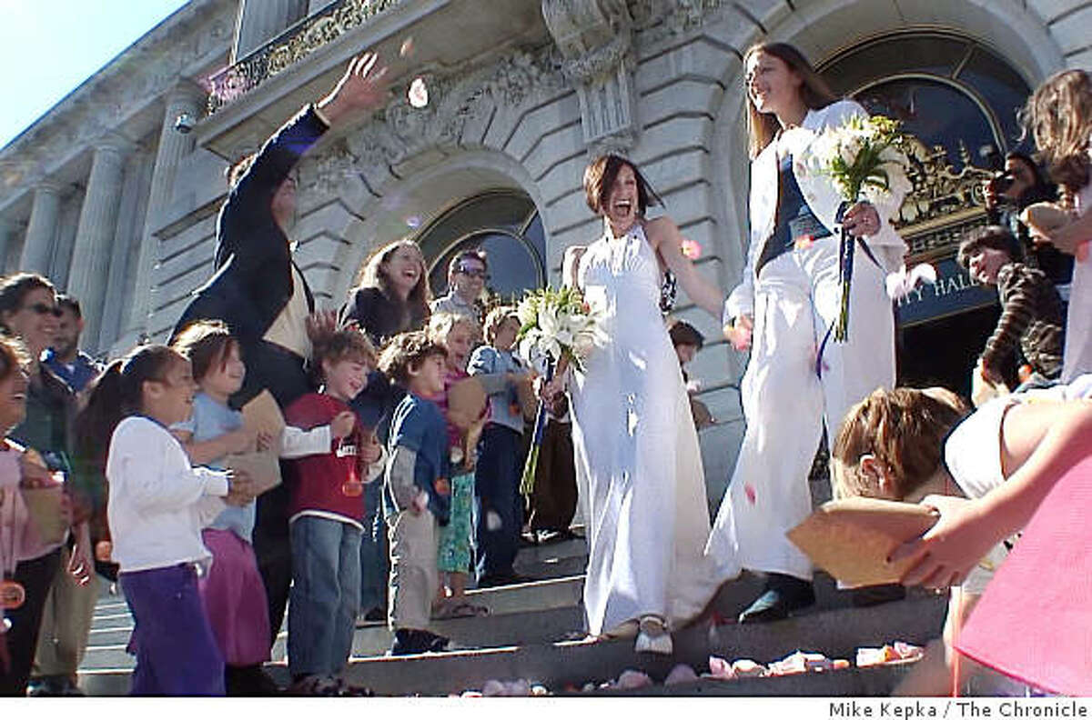 Erin Carder's (left) 1st grade class from Creative Arts Charter School, a public elementary school, throws rose petals on the steps of City Hall after she and her partner, Kerri McCoy, were married on Friday Oct. 10, 2008 in San Francisco, Calif.