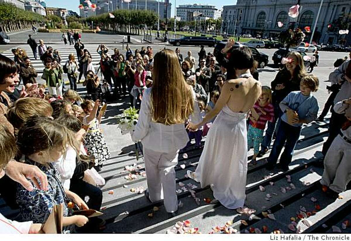 Creative Arts Charter School first graders throw rose petals in the air as their teacher, Erin Carder (middle right), walks down the steps of City Hall after getting married to Kerri McCoy (middle, left) in San Francisco, Calif., on Friday, October 10, 2008.