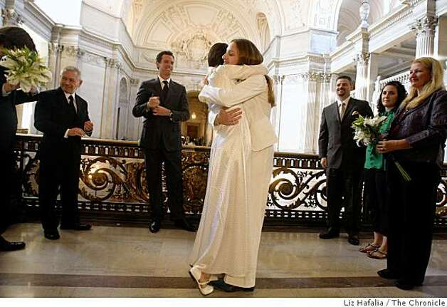 Erin Carder (L) and Kerri McCoy (R) hug after getting married by Mayor Gavin Newsom at City Hall in San Francisco, Calif., on Friday, October 10, 2008. Photo: Liz Hafalia, The Chronicle