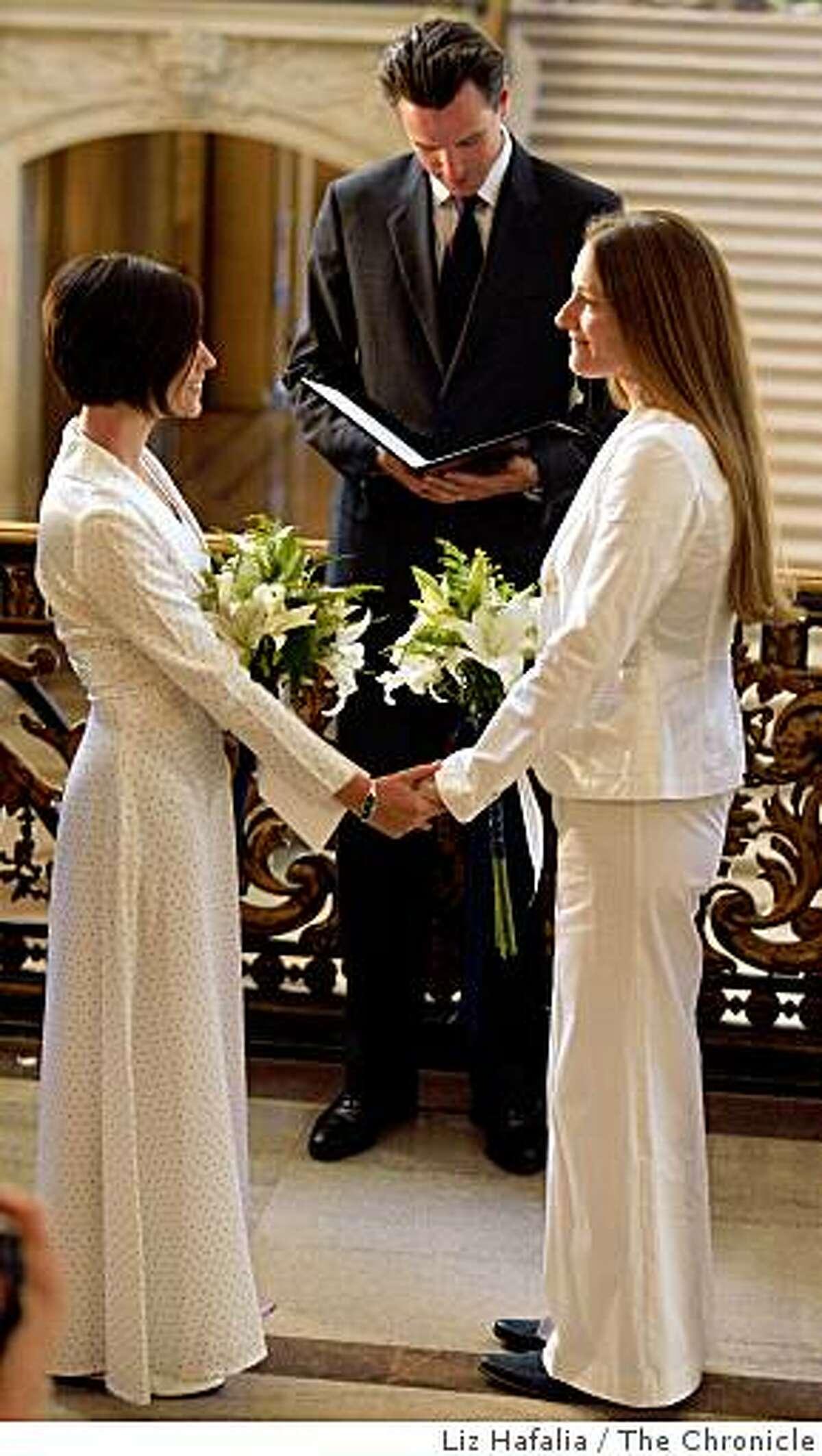 Mayor Gavin Newsom marries Erin Carder (left) and Kerri McCoy at City Hall in San Francisco, Calif., on Friday, October 10, 2008.