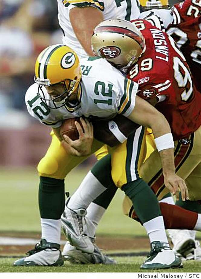 Green Bay Packers quarterback Aaron Rodgers is sacked by 49ers Manny Lawson in the 1st quarter.The San Francisco 49ers host the Green Bay Packers in an NFL preseason game at Candlestick Park in San Francisco, Calif., on August 16, 2008. Photo: Michael Maloney, SFC