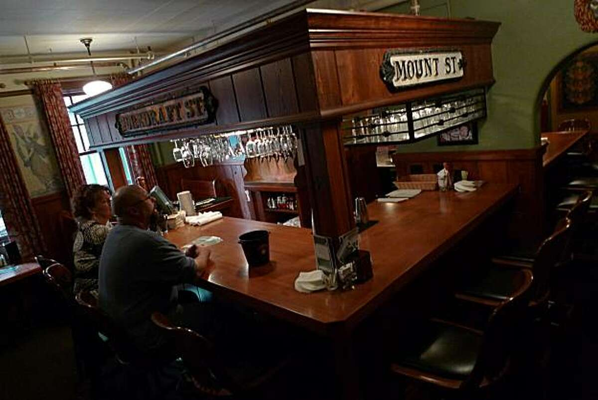 Patrons enjoy a brew at one of the bars in the Edgefield, a former county poor farm converted into a resort.
