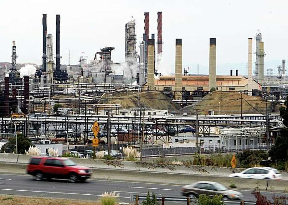 Motorists on Interstate 580 drive past the Chevron oil refinery in Richmond, Calif. on Thursday, Oct. 11, 2007. PAUL CHINN/The Chronicle Photo: Paul Chinn, The Chronicle