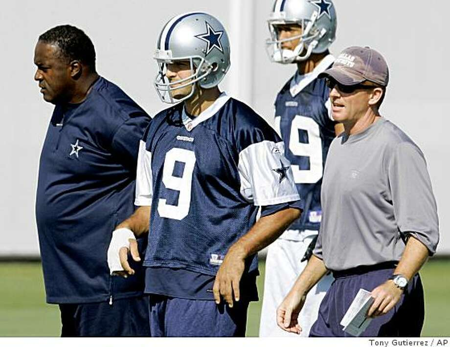 Dallas Cowboys wide receivers coach Ray Sherman, left, quarterback Tony Romo and offensive coordinator Jason Garrett, right, look on during practice at the Cowboys training facility in Irving, Texas, Friday, Oct. 17, 2008. Photo: Tony Gutierrez, AP