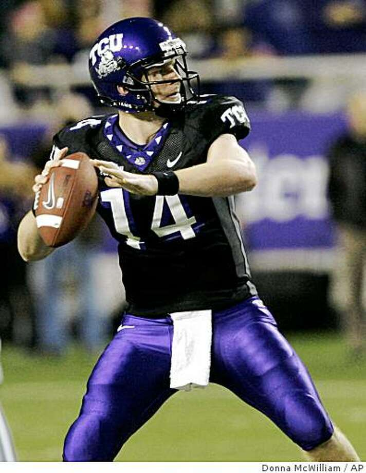 TCU quarterback Andy Dalton looks to pass in the first half of an NCAA college football game against BYU in Fort Worth, Texas, Thursday, Oct. 16, 2008. (AP Photo/Donna McWilliam) Photo: Donna McWilliam, AP