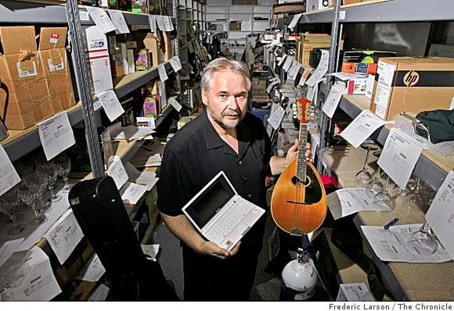 Peter Vasilev the owner of iSold it store in Pleasent Hill, Calif., stands amongst all the items he'll try to sell in eBay on Thursday October 16, 2008. Photo: Frederic Larson, The Chronicle