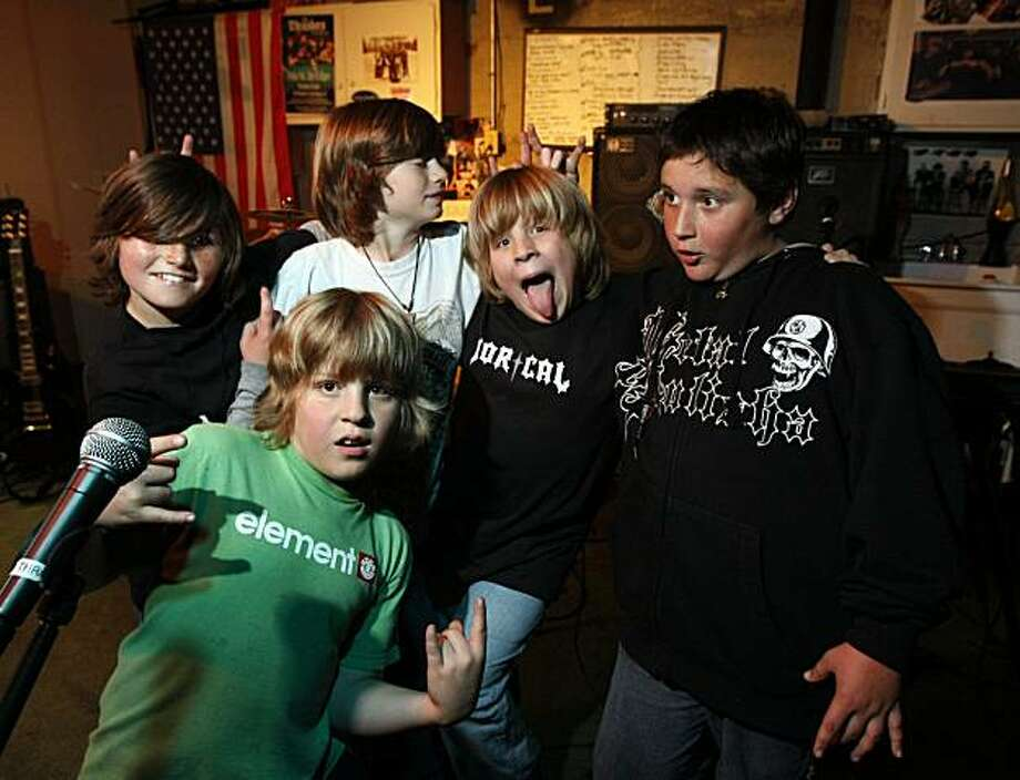 The Thrashers, Nine-year-old Pacifica California boys pose for a portrait in their garage studio L to R are Geddy, who play lead guitar, Drums, is Chris (in green T-shirt), Brandon, keyboard, Nick Bass and singer and Charley guitar. Tuesday April 27, 2010 Photo: Lance Iversen, The Chronicle