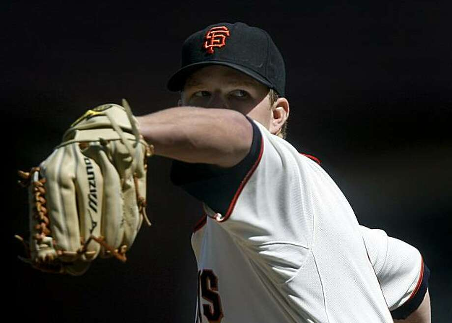 Pitcher Matt Cain zeroes in on the strike zone in the top of the eighth inning of the San Francisco Giants' 6-1 win over the Colorado Rockies at AT&T Park in San Francisco on Saturday. Photo: Paul Chinn, The Chronicle