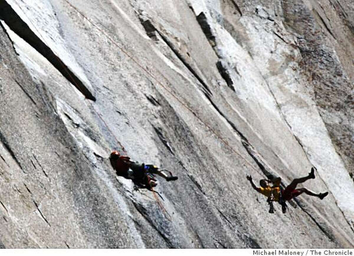 Yuji Hirayama, right, swings out from under the Boot Flake in a pendulum move to swing 50 feet to the left past his partner Hans Florine. Hans Florine, 44, of Lafayette, Calif., and Yuji Hirayama, 39, of Hidaka, Japan, broke their own speed record climb up the Nose of the internationally famous granite cliff known as El Capitan in Yosemite National Park on Sunday, October 12, 2008. Their time was 2 hours, 37 minutes and 5 seconds, beating their old record by over 6 minutes.