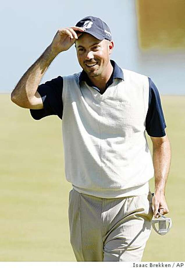 Matt Kuchar tips his hat after sinking a putt on the 18th green during the second round of the Justin Timberlake Shriners Hospitals for Children Open golf tournament at TPC Summerlin in Las Vegas on Friday, Oct. 17, 2008.  (AP Photo/Isaac Brekken) Photo: Isaac Brekken, AP