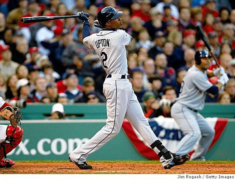 BOSTON - OCTOBER 13:  B.J. Upton #2 of the Tampa Bay Rays hits a three run home run in the third inning against the Boston Red Sox in game three of the American League Championship Series during the 2008 MLB playoffs at Fenway Park on October 13, 2008 in Boston, Massachusetts.  (Photo by Jim Rogash/Getty Images) Photo: Getty Images