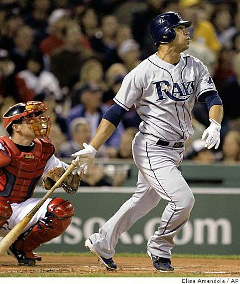 Tampa Bay Rays' Carlos Pena and Boston Red Sox catcher Kevin Cash watch Pena's two run home run in the first inning in Game 4 of the American League baseball championship series in Boston, Tuesday, Oct. 14, 2008. (AP Photo/Elise Amendola) Photo: Elise Amendola, AP