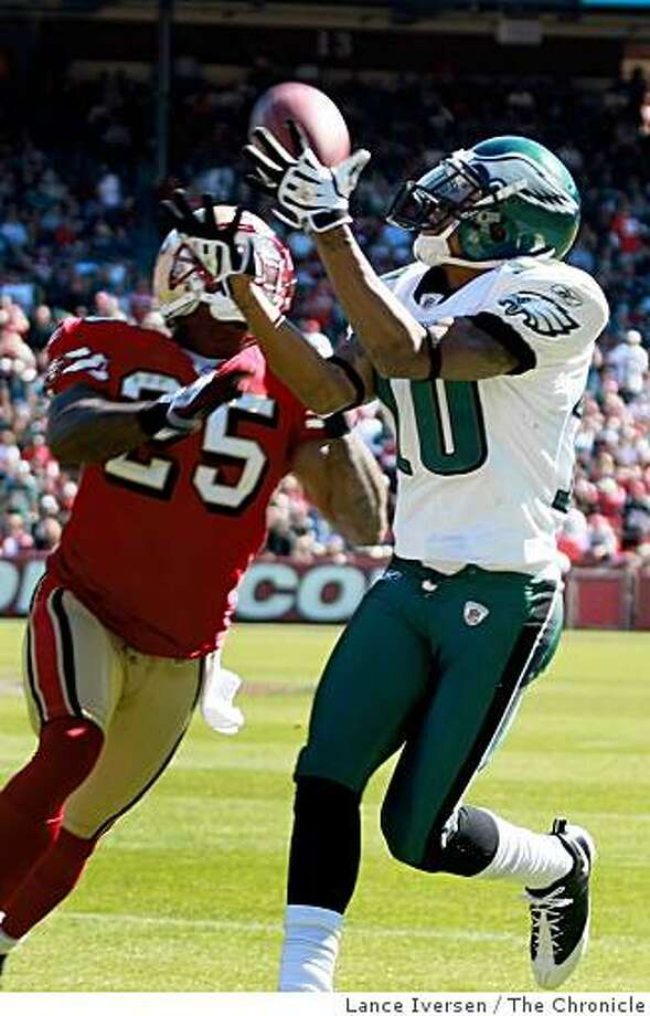 Eagles DeSean Jackson hauls in a first down pass from Donovan McNabb in front of 49ers Tarell Brown in first half action. Philadelphia Eagles defeated the San francisco 49ers 40-26  October 12, 2008 in San Francisco Photo: Lance Iversen, The Chronicle