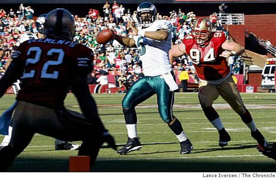 Eagles quarterback Donovan McNabb sets to fire a pass in front of Niners Justin Smith late into the fourth quarter. The Philadelphia Eagles defeated the San Francisco 49ers in San Francisco October 12, 2008  40-26 Photo: Lance Iversen, The Chronicle