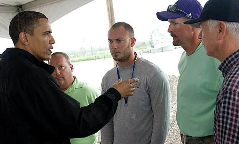 US President Barack Obama speaks with local fishermen about how they are affected by the BP oil spill after meeting with officials at Coast Guard Station Venice in Venice, Louisiana, May 2, 2010. Obama visits the area as crews try to stem the oil flow streaming from the wreakage of BP's Deepwater Horizon rig, which sank on April 22, two days after a massive explosion killed 11 workers. Photo: Saul Loeb, AFP/Getty Images