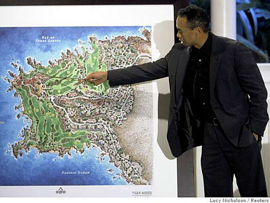 Tiger Woods talks at a press conference to announce Punta Brava, a piece of land set to be developed into a private golf and ocean club community in Ensenada, Mexico, at the Bel Air Hotel in Los Angeles, October 7, 2008.  Tiger Woods Design and The Flagship Group are jointly investing in the project.   REUTERS/Lucy Nicholson   (UNITED STATES) Photo: Lucy Nicholson, Reuters