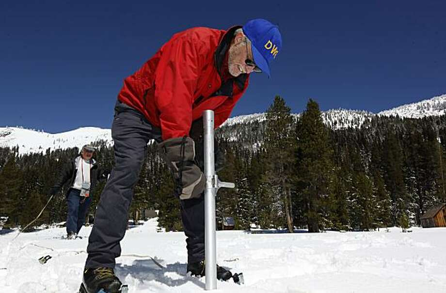 Frank Gehrke, Chief of California Cooperative Snow Surveys, collects a sample along with John Deam, California Department of Water Resources, Engineering Associate, during the last snow survey of the year on Friday, Apr. 30, 2010, in Phillips Station, Calif. The findings at Phillips Station were reported at 143% of average for a May 1st reading. Photo: Michael Macor, The Chronicle