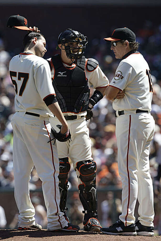 Jonathan Sanchez (l to r) talks with Eli Whiteside, catcher and Dave Righetti pitching coach on the mound during the fifth inning during the San Francisco Giants versus Colorado Rockies game at AT&T Park in San Francisco, Calif. on Sunday May 2, 2010. Final Score: Giants 1 - Rockies 4 Photo: Lea Suzuki, The Chronicle