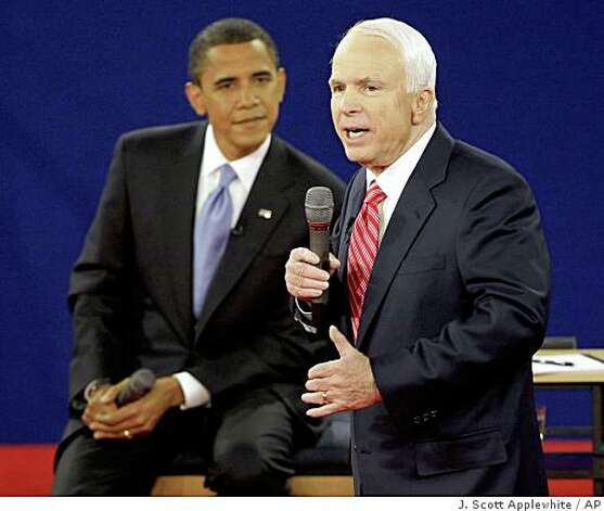 Republican presidential candidate Sen. John McCain, R-Ariz., right, speaks as Democratic presidential candidate Sen. Barack Obama, D-Ill., listens during a townhall-style presidential debate at Belmont University in Nashville, Tenn., Tuesday, Oct. 7, 2008. (AP Photo/J. Scott Applewhite) Photo: J. Scott Applewhite, AP