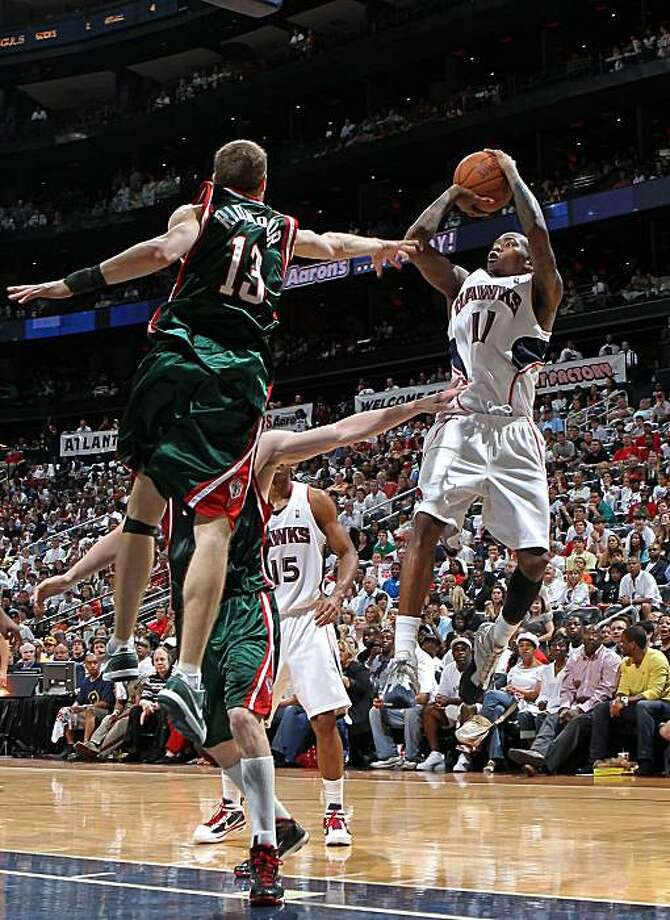 ATLANTA - MAY 2:  Guard Jamal Crawford #11 of the Atlanta Hawks shoots over guard Luke Ridnour #13 of the Milwaukee Bucks during Game Seven of the Eastern Conference Quarterfinals between the Milwaukee Bucks and the Atlanta Hawks during the 2010 NBA Playoffs at Philips Arena on May 2, 2010 in Atlanta, Georgia. The Hawks beat the Bucks 95-74.  NOTE TO USER: User expressly acknowledges and agrees that, by downloading and/or using this photograph, user is consenting to the terms and conditions of the Getty Images License Agreement. Photo: Mike Zarrilli, Getty Images