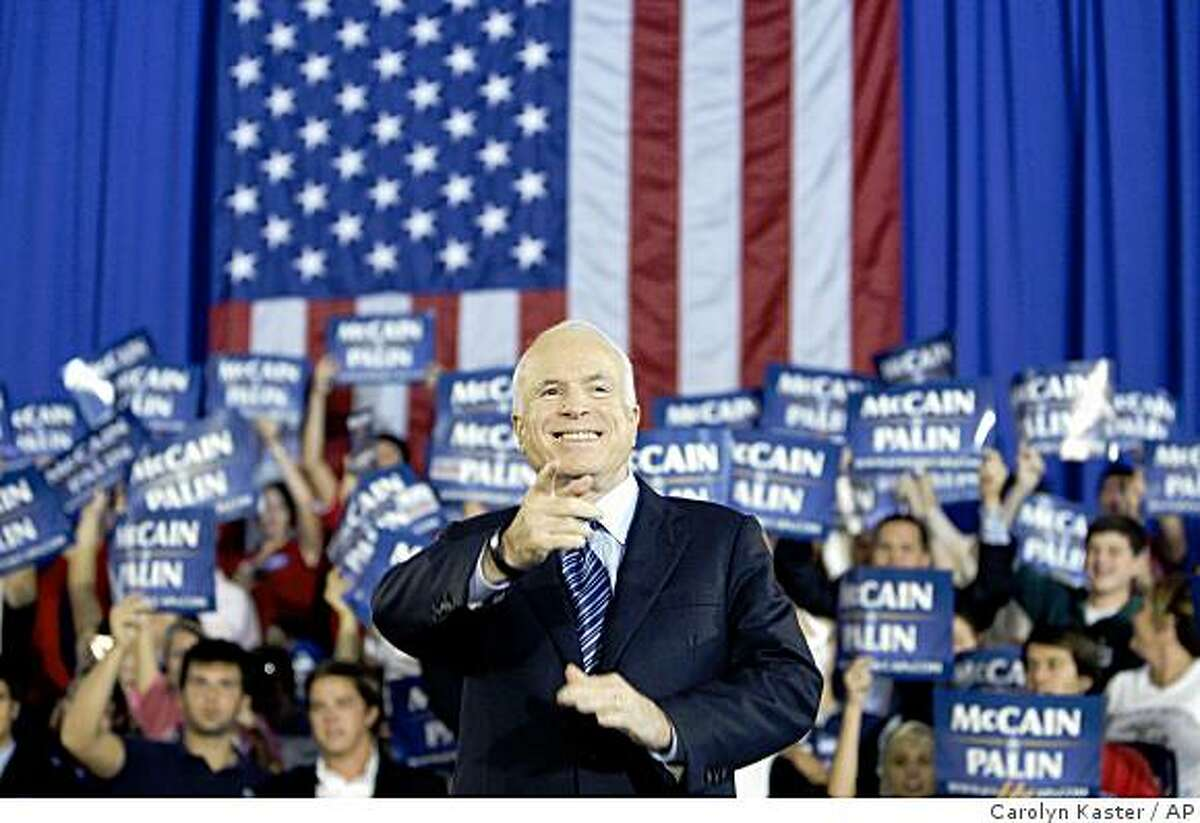 Republican presidential candidate, Sen. John McCain, R-Ariz., gestures to the crowd as he is being introduced at a rally at Cape Fear Community College in Wilmington, N.C., Monday, Oct. 13, 2008. (AP Photo/Carolyn Kaster)