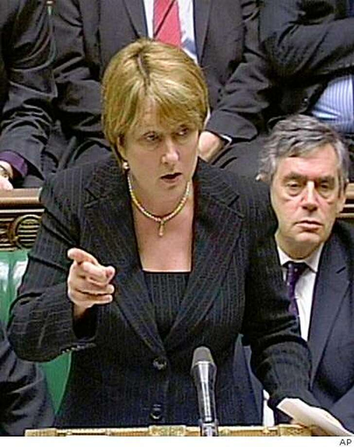 Britain's Home Secretary Jacqui Smith, reads a statement to the House of Commons, Monday Oct. 13, 2008. Plans to increase pre-charge terror detention to 42 days will be dropped from the Counter Terrorism Bill, Home Secretary Jacqui Smith said tonight. The measure will instead be the subject of a separate piece of legislation to be brought to Parliament if required, she told lawmakers after the proposal was defeated in the House of Lords by 191 votes. At right listening is Britain's Prime Minister Gordon Brown. (AP Photo/PA)  **  UNITED KINGDOM OUT NO SALES NO ARCHIVE  ** Photo: AP