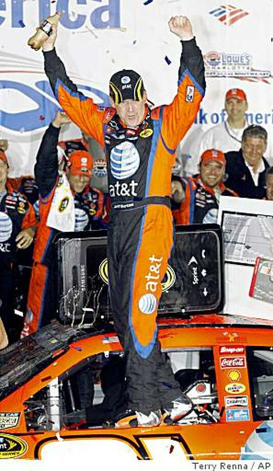 Jeff Burton celebrates after winning the NASCAR Sprint Cup Series Bank of America 500 auto race at Lowe's Motor Speedway in Concord, N.C., Saturday, Oct. 11, 2008. (AP Photo/Terry Renna) Photo: Terry Renna, AP