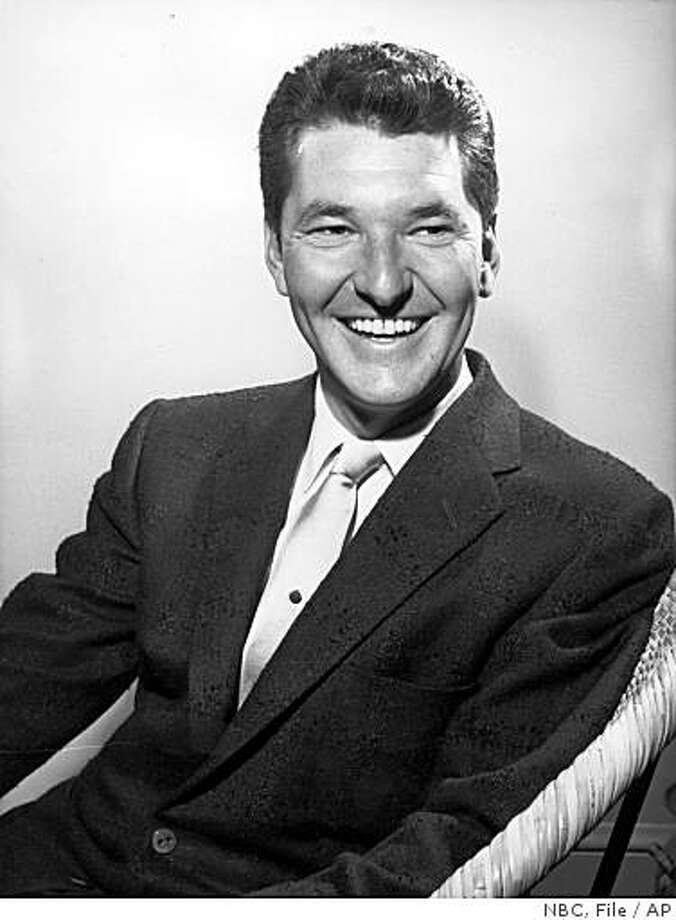 """** FILE ** In this 1958 file photo originally released by NBC, Jack Narz, host of the NBC game show, """"Dotto,"""" is shown.  Narz, a longtime game show host who was an early victim of the quiz show scandals of the 1950s when a show he was hosting was canceled, has died. He was 85. Narz died Wednesday, Oct. 15, 2008, at Cedars-Sinai Medical Center from complications of a stroke, his wife, Delores, said Thursday.  (AP Photo/NBC, file) ** NO SALES ** Photo: NBC, File, AP"""